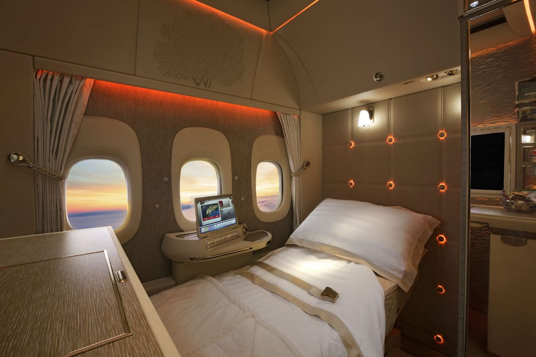 In interior photograph showing the 'Game Changer' First Class cabins on board an Emirates Airline Boeing 777 by photographer, Duncan Chard
