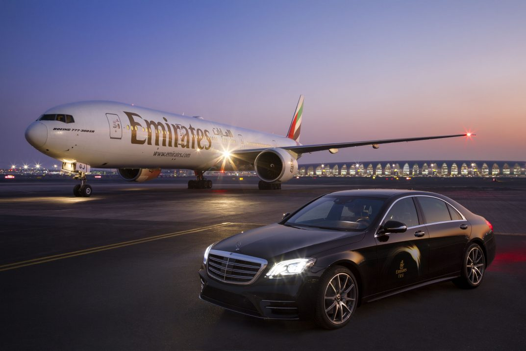 A photograph of Emirates Airways Boeing 777 and Mercedes S-Class at Dubai Airport, by photographer, Duncan Chard