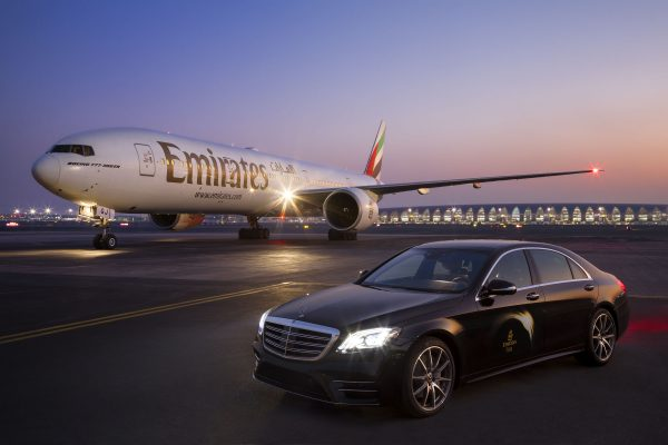 Emirates Airways Boeing 777 and Mercedes S-Class at Dubai Airport